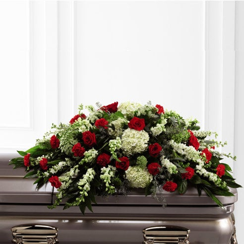 Red rose casket spray with white hydrangea, cheap funeral flowers delivery