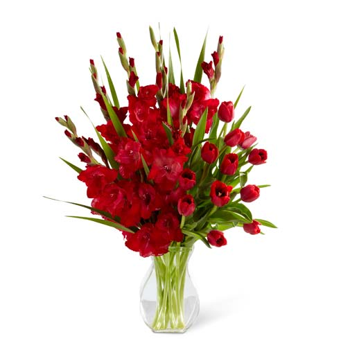 Red sympathy arrangement with tulips and gladiolus
