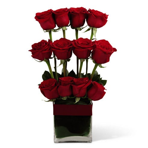 Roses for men in a modern red rose arrangement with one dozen roses delivery