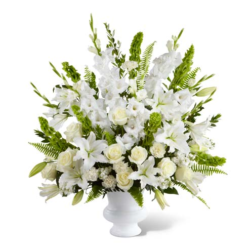 Beautiful white roses, bells of ireland and oriental lilies in sympathy arrangement