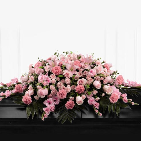Pink Floral casket spray with roses, carnations and lilies