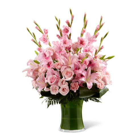 Sympathy flower bouquet with pink gladiolus, light pink roses, and asiatic lilies