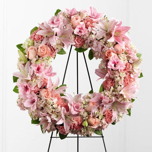 Pink sympathy wreath with roses, lilies and hydrangea with blush colored flowers