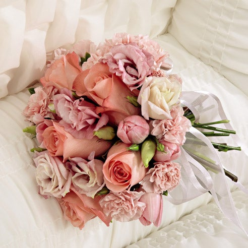 Florist delivered pink flower casket arrangement with roses and tulips