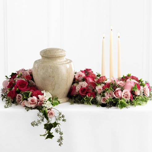 Remembrance arrangement with light pink roses and spray roses