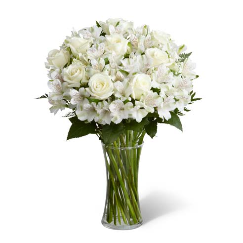 Sympathy bouquet with white roses and peruvian lilies in gathering vase