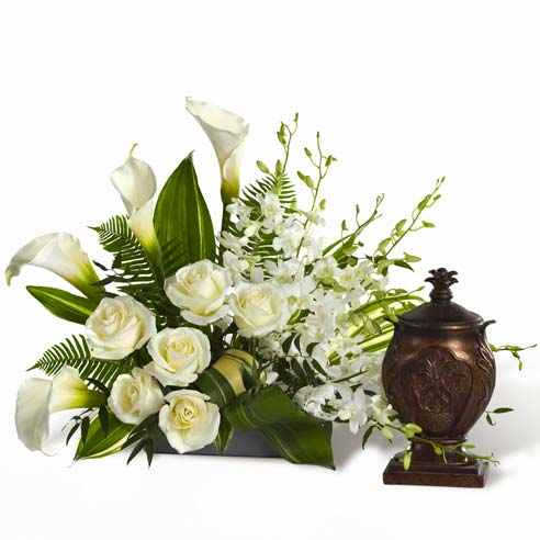White rose and white calla lily urn flower arrangement for funeral or wake