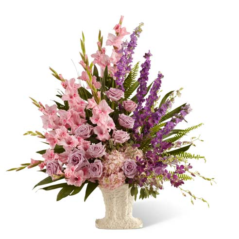 Lavender roses, pink gladiolus and purple orchids in sympathy vase arrangement