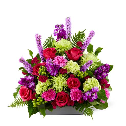 Hot pink spray roses and fuchsia carnation funerals arrangement for men