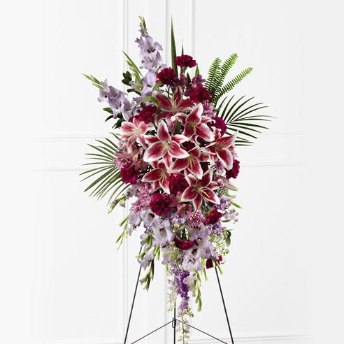 Stargazer funeral flower standing spray with stand for funeral flower delivery