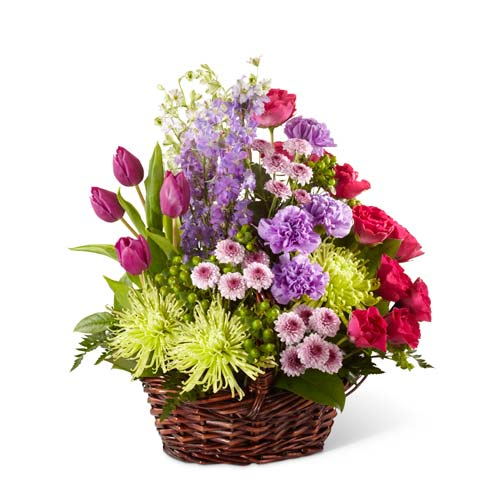 Sympathy flower arrangement with purple tulips, carnations and red roses