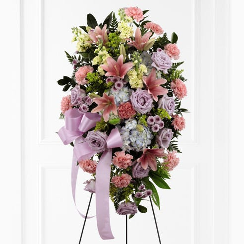 Sympathy oval funeral flower standing spray of lavender roses, blue hydrangea