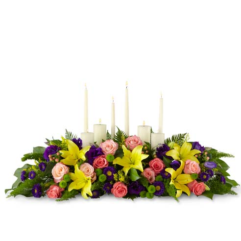 Yellow lily, peach rose and white candles centerpiece with 8 candles