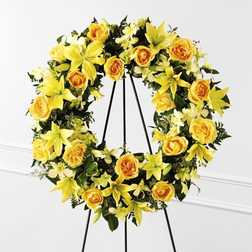 Yellow rose and lily wreath standing spray for funeral, visitation and wake