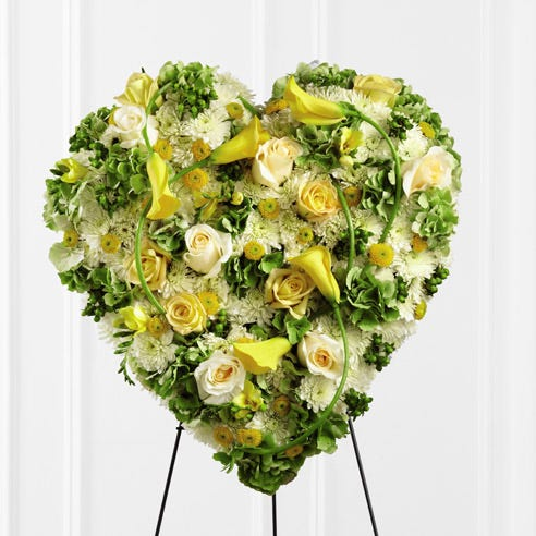 funeral heart flowers standing spray and tropical heart funeral arrangement