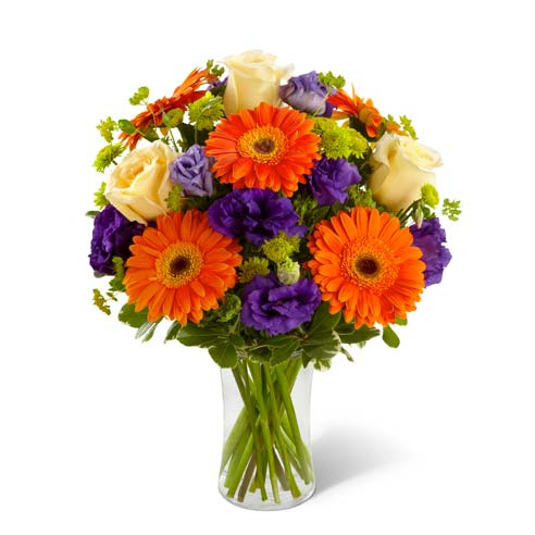 White roses, orange gerbera daisies and purple flowers