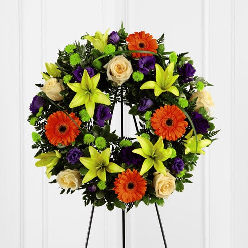 Send flowers online with this tropical flowers funeral wreath of cheap flowers
