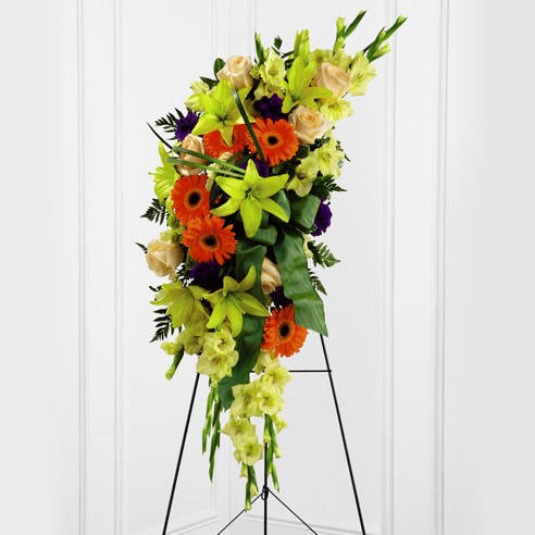 Oval funeral flowers standing spray delivery with tropical flowers and easel