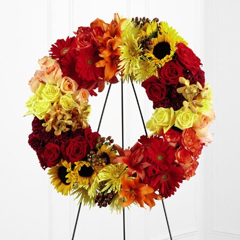 Sunflower funeral flower wreath delivery from send flowers, ring sympathy wreath