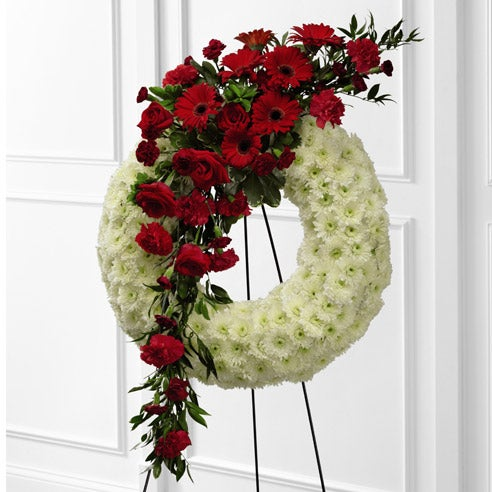 funeral wreath delivery with red roses and white carnations, cheap flowers standing spray