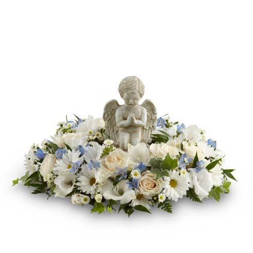 white flower angel funeral flowers, figurine flower arrangement with angel figure