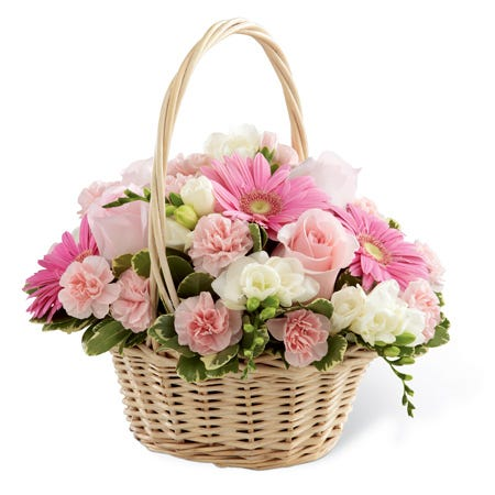 Sympathy basket with pink gerbera daisies and light pink roses in handled basket