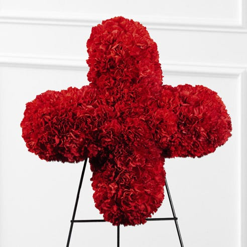 red cross flower standing spray delivery with crimson red carnations