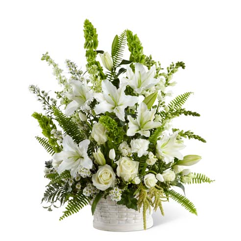 White sympathy flower arrangement with lilies, tulips and asters