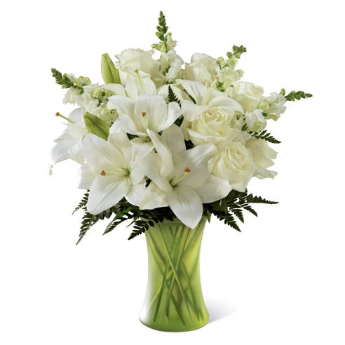 White roses and white lilies in a green vase