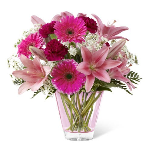 Fuchsia gerbera daisies, pink Asiatic Lilies and hot pink carnations
