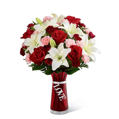 White lily and red rose bouquet with dangle love text tag in red vase