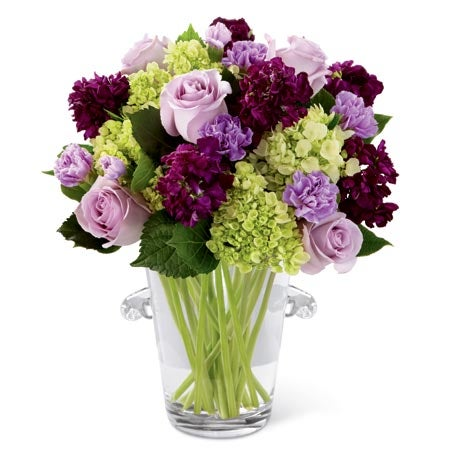 Lavender roses and purple roses in a purple flower arrangement from Send Flowers