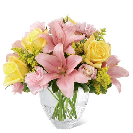 Pink lilies with yellow roses in a glass vase from send flowers.com