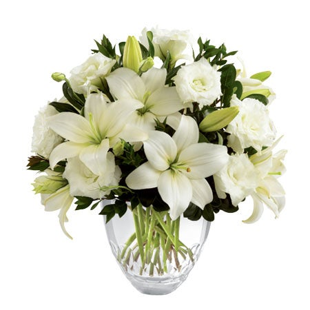 White asiatic lilies, lisianthus and white flowers in a floral delivery