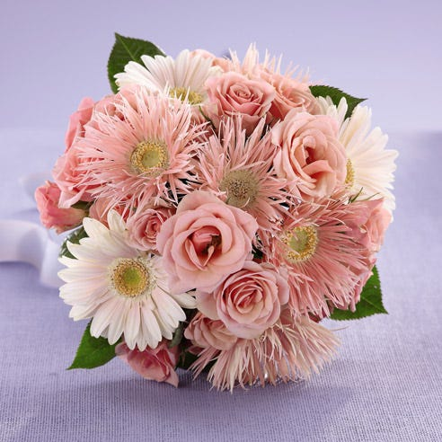 Pink gerbera daisies in a florist delivered bouquet