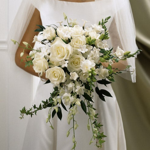 Wedding bouquet and white wedding bouquet with white roses and white flowers
