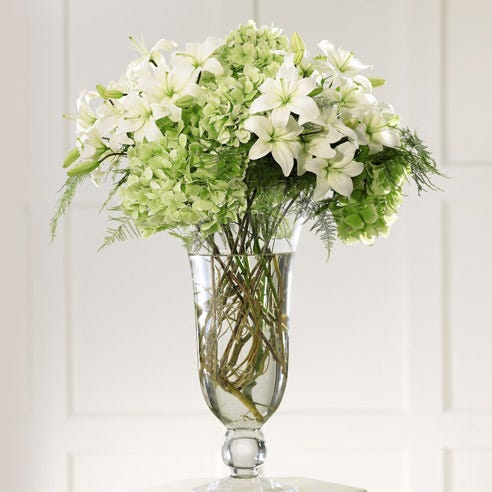 Altar flower arrangements and white orchids