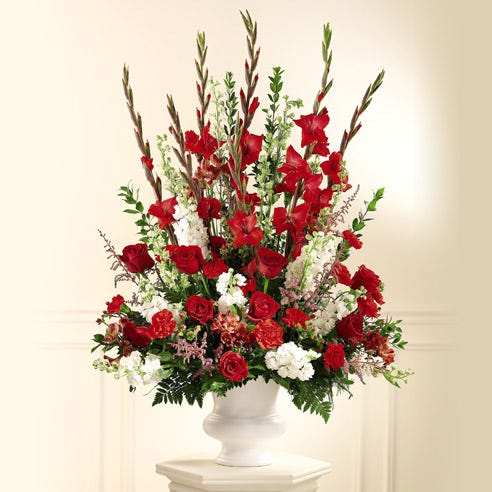 Sympathy red rose and carnations flowers arrangement with larkspur and pink astilbe