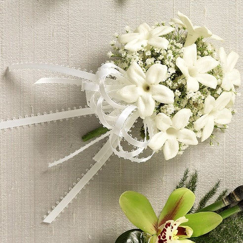 White flower corsage with cheap flowers and white stephanotis for same day delivery