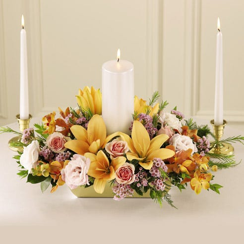 3 candle flower centerpiece with mango mokara orchids, pink lily and pink roses