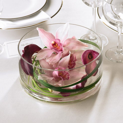 Three lavender cymbidium orchids in centerpiece, floating orchids and floating lily centerpiece