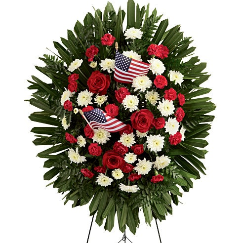 Cheapest standing spray with red spray roses, American flags, and patriotic flowers