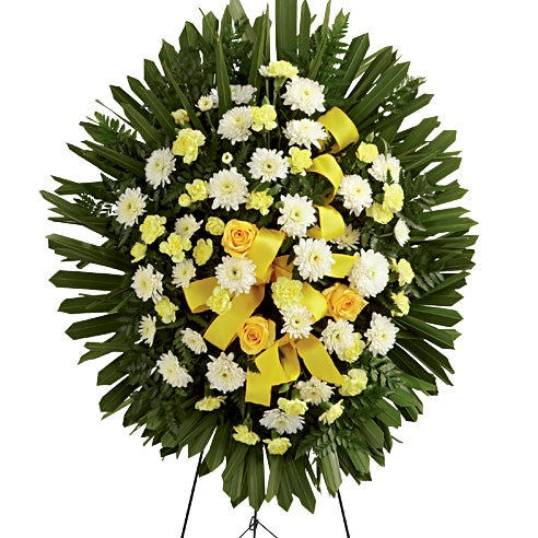 Yellow rose standing spray and funeral lower arrangement for men