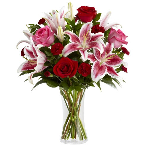 Red roses, stargazer lilies and deep red carnations