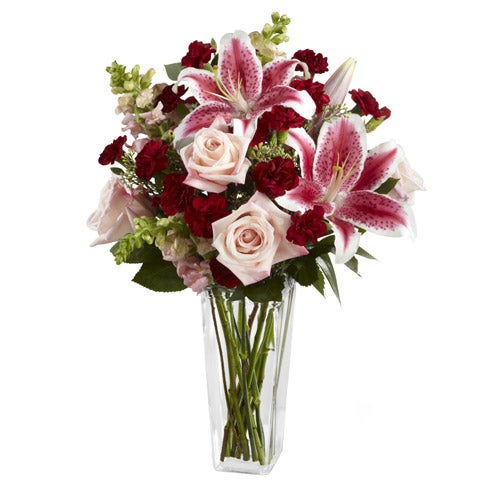 Pale pink roses, Stargazer lilies and burgundy mini carnations