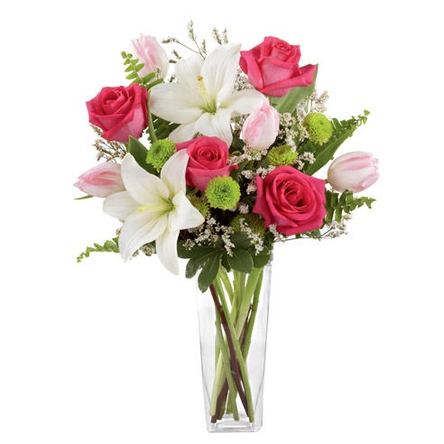 Fuchsia roses and light pink tulips bouquet with white asiatic lily and green vase