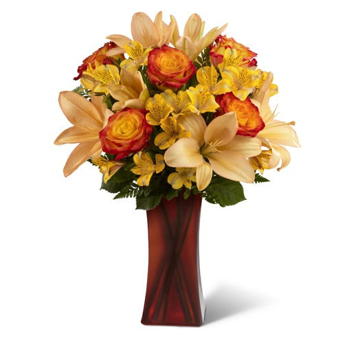 Bi-colored roses, yellow peruvian lilies and orange lilies