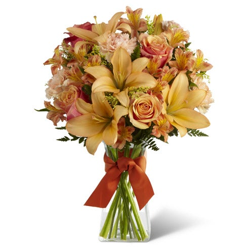 Orange roses, peach asiatic lilies and orange carnations for same day flowers