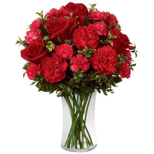 Romantic floral bouquet with red roses, red carnations and pink carnations
