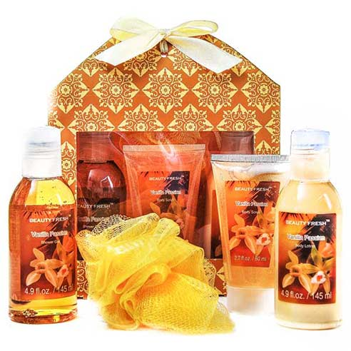 Vanilla body scrub, gel, lotion, and loofah sponge in a spa gift